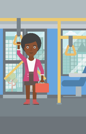 handgrip: An african-american woman traveling by public transport. Young woman standing inside public transport. Woman traveling by passenger bus or subway. Vector flat design illustration. Vertical layout.