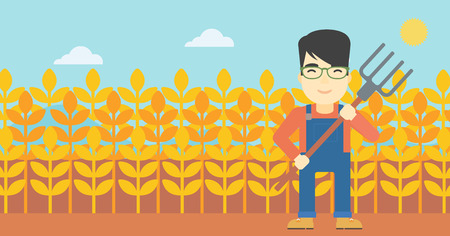 An asian smiling farmer holding a pitchfork. Farmer standing on the background of wheat field. Vector flat design illustration. Horizontal layout.