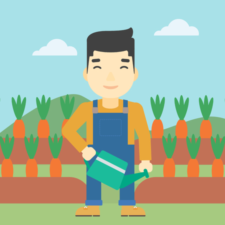 asian farmer: An asian farmer holding a watering can. Farmer watering carrots. Farmer standing on the background of carrots growing on field. Square layout.