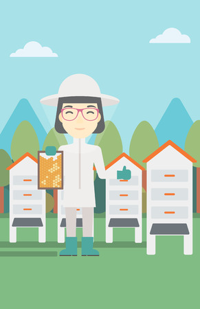 An asian female farmer wearing protective suit. Bee-keeper holding a framework in hand and showing thumb up on the background of apiary. Vector flat design illustration. Vertical layout.