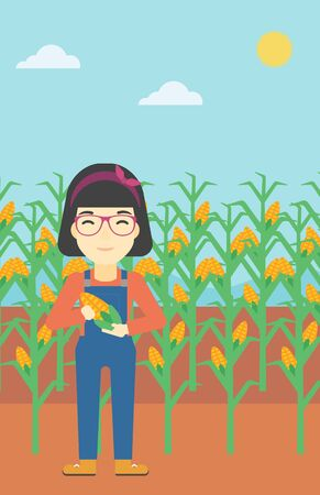 corn field: An asian female farmer holding a corn cob. Young farmer standing on the background of corn field. Vector flat design illustration. Vertical layout.
