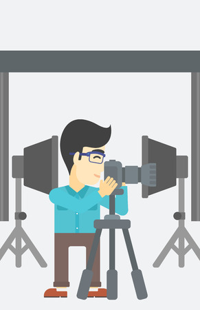 An asian young photographer working with camera on a tripod in photo studio. Man taking photo with professional digital camera in the studio. Vector flat design illustration. Vertical layout. Stok Fotoğraf - 60115820
