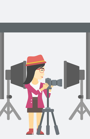 An asian young photographer working with camera on a tripod in photo studio. Woman taking photo with professional digital camera in the studio. Vector flat design illustration. Vertical layout. Stok Fotoğraf - 60115831