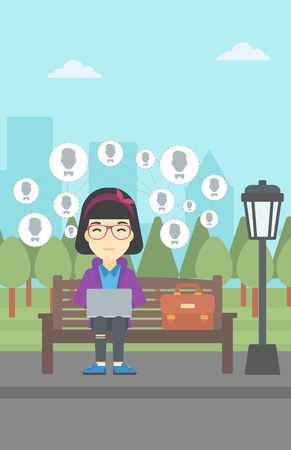 woman using laptop: Asian woman sitting on bench in park and using a laptop with network avatar icons above. Business woman working on a laptop. Social network concept. Vector flat design illustration. Vertical layout.