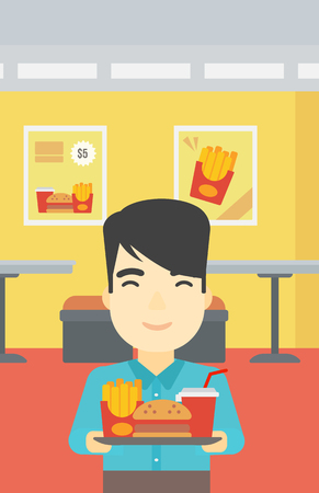 lunch tray: An asian young man holding tray full of junk food on a cafe background. Smiling man in fast food restaurant. Man having lunch in a fast food restaurant. Vector flat design illustration. Vertical layout.
