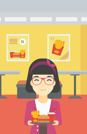 lunch tray: An asian woman holding tray full of junk food on a cafe background. Smiling woman in fast food restaurant. Woman having lunch in fast food restaurant. Vector flat design illustration. Vertical layout.