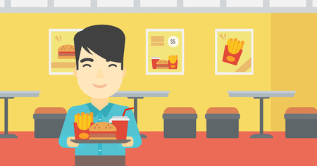 An asian young man holding tray full of junk food on a cafe background. Smiling man in fast food restaurant. Man having lunch in a fast food restaurant. Vector flat design illustration. Horizontal layout.