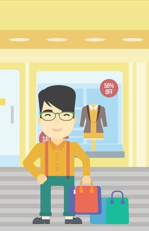 An asian man holding shopping bags on the background of boutique window with dressed mannequins. Happy young man carrying shopping bags. Vector flat design illustration. Vertical layout. Illustration