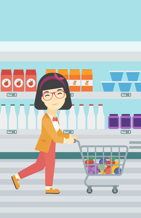 An asian young woman pushing a supermarket cart with some goods in it. Customer shopping at supermarket with cart full with groceries. Vector flat design illustration. Vertical layout. Vectores