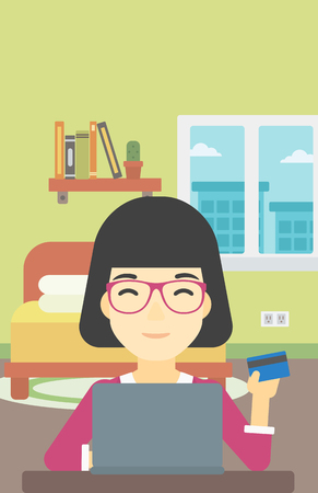 woman credit card: An asian woman holding a credit card and using laptop for online shopping. Woman shopping online at home. Woman making online payment. Vector flat design illustration. Vertical layout. Illustration