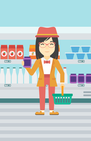An asian woman holding shopping basket in one hand and milk product in the other. Female customer shopping at supermarket with basket. Vector flat design illustration. Vertical layout. Vectores