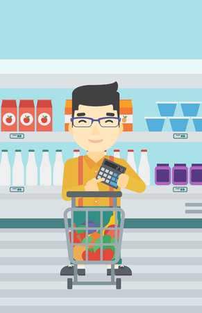 consumer goods: An asian young man at the supermarket with calculator and supermarket trolley full with products. Man checking prices with calculator. Vector flat design illustration. Vertical layout.