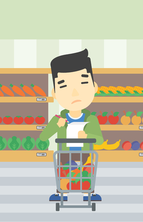 supermarket trolley: An asian thoughtful man standing at the supermarket with supermarket trolley full with products and holding a shopping list in hands. Vector flat design illustration. Vertical layout. Illustration