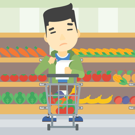 An asian thoughtful man standing at the supermarket with supermarket trolley full with products and holding a shopping list in hands. Vector flat design illustration. Square layout.