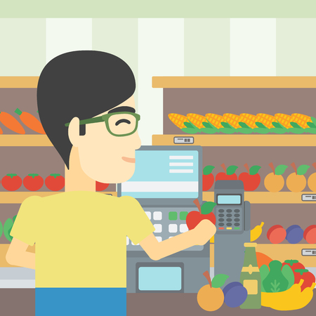 checkout: An asian young male cashier standing at the checkout in supermarket. Male cashier working at checkout in supermarket. Vector flat design illustration. Square layout.