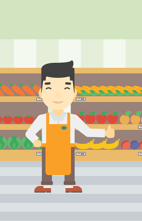 An asian young male supermarket worker showing thumb up on the background of shelves with vegetables and fruits in supermarket. Vector flat design illustration. Vertical layout.