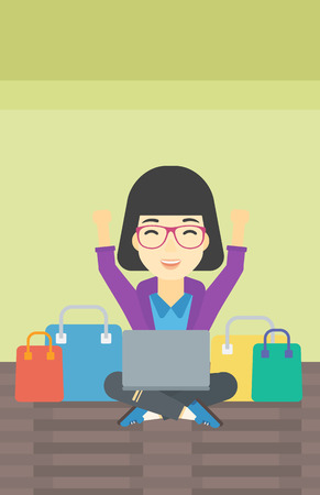 An asian young woman with hands up using laptop for shopping online. Customer sitting with shopping bags around him. Woman doing online shopping. Vector flat design illustration. Vertical layout.