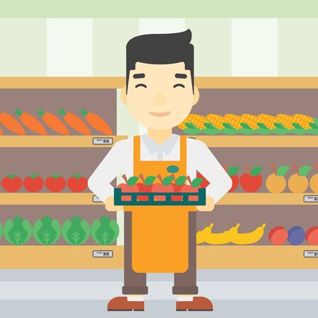 An asian young male supermarket worker holding a box with apples on the background of shelves with vegetables and fruits in supermarket. Vector flat design illustration. Square layout. Vettoriali