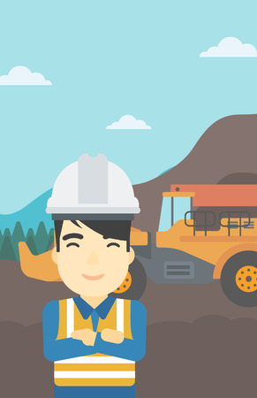 An asian confident coal miner. A miner standing in front of a big mining equipment on the background of coal mine. Vector flat design illustration. Vertical layout.