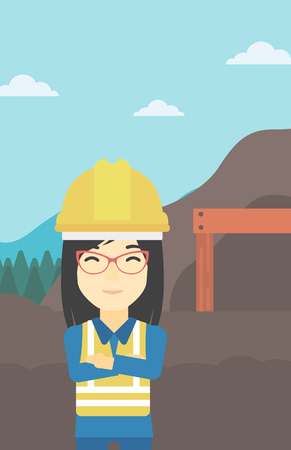 An asian confident coal miner. Female miner standing in front of a big mining equipment on the background of coal mine. Vector flat design illustration. Vertical layout.