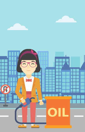 An asian woman standing near oil barrel. Woman holding gas pump nozzle on a city background. Woman with gas pump and oil barrel. Vector flat design illustration. Vertical layout. Illustration