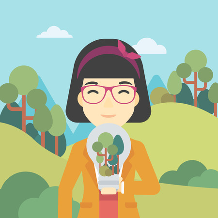 basic care: An asian woman standing on the background of green forest and holding in hands a big lightbulb with trees inside. Green energy concept. Vector flat design illustration. Square layout.