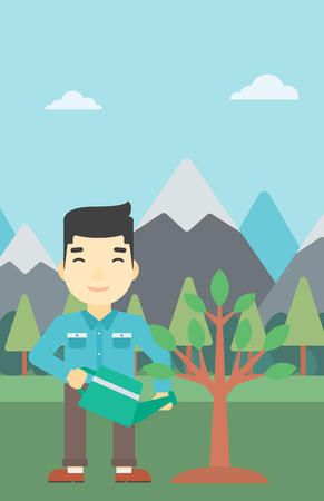 An asian man watering a tree on the background with mountain. Young friendly man takes care of the environment. Vector flat design illustration. Vertical layout.