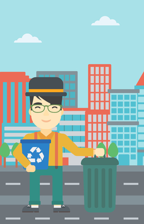 An asian young man carrying recycling bin. Man with recycling bin standing near a trash can on a city background. Vector flat design illustration. Vertical layout.