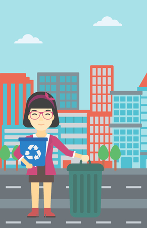 An asian young woman carrying recycling bin. Woman with recycling bin standing near a trash can on a city background. Vector flat design illustration. Vertical layout.
