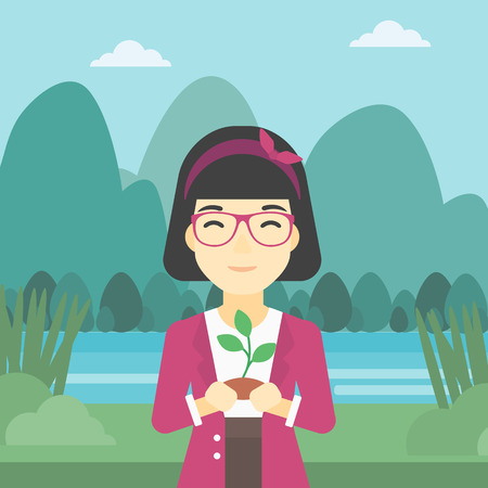 hands holding plant: An asian young woman holding in hands a small plant in soil on the background of landscape with mountains and river. Vector flat design illustration. Square layout.