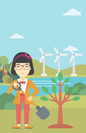 An asian young woman plants a tree. Woman standing with shovel near newly planted tree. Woman planting tree on a background of wind turbines. Vector flat design illustration. Vertical layout.