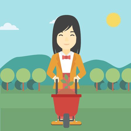 An asian young woman standing with a plant and soil in a wheelbarrow on the background of mountain landscape. Vector flat design illustration. Square layout.