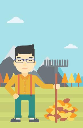 vertical garden: An asian young man raking autumn leaves. Man with rake standing near tree and heap of autumn leaves. Man tidying autumn leaves in garden. Vector flat design illustration. Vertical layout.