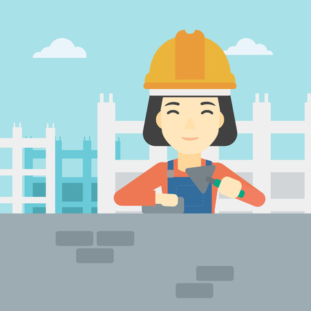 bricklayer: A female bricklayer in uniform and hard hat. Female bricklayer working with a spatula and a brick in hands on construction site. Vector flat design illustration. Square layout.