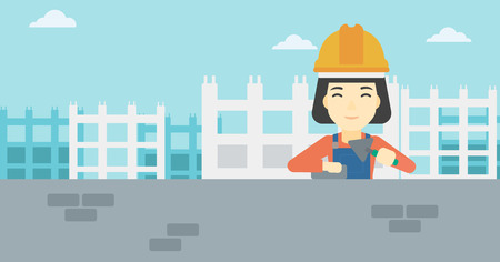 A female bricklayer in uniform and hard hat. Female bricklayer working with a spatula and a brick in hands on construction site. Vector flat design illustration. Horizontal layout.