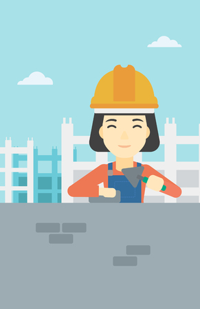 brick and mortar: A female bricklayer in uniform and hard hat. Female bricklayer working with a spatula and a brick in hands on construction site. Vector flat design illustration. Vertical layout. Illustration