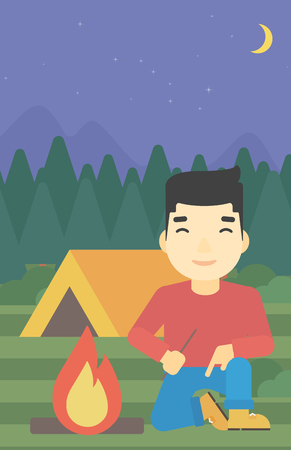 kindling: An asian man kindling a campfire on the background of camping site with tent. Tourist relaxing near campfire. Vector flat design illustration. Vertical layout.