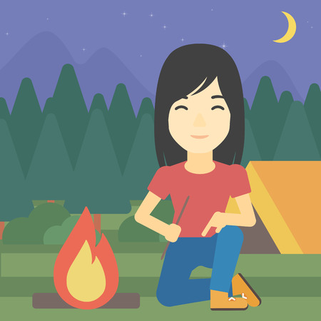 kindling: An asian woman kindling campfire on the background of camping site with tent. Tourist relaxing near campfire. Woman sitting near campfire. Vector flat design illustration. Square layout.