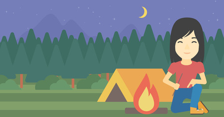 kindling: An asian woman kindling campfire on the background of camping site with tent. Tourist relaxing near campfire. Woman sitting near campfire. Vector flat design illustration. Horizontal layout.