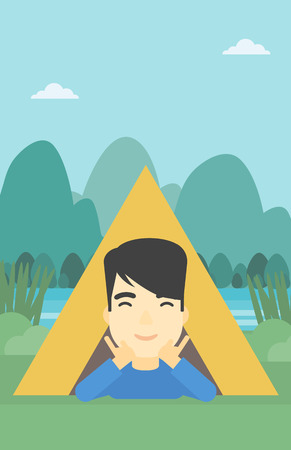 An asian man crawling out from a camping tent. Man with his hands on cheek lying in camping tent and relaxing. Vector flat design illustration. Vertical layout.