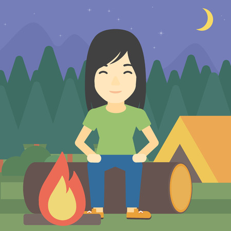 camping site: An asian woman sitting on a log near a fire on a background of camping site with tent. Woman sitting near a campfire at a campsite. Vector flat design illustration. Square layout.