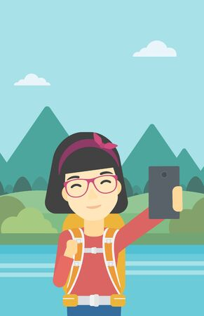 woman cellphone: An asian woman making selfie on the background of mountains. Travelling woman with backpack taking photo with cellphone. Vector flat design illustration. Vertical layout.