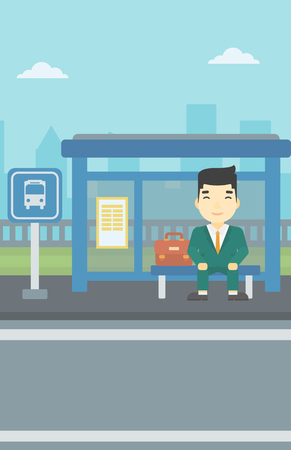 An asian young man waiting for a bus at a bus stop on a city background. Young man sitting at the bus stop. Vector flat design illustration. Vertical layout. Ilustracja