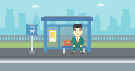 An asian young man waiting for a bus at a bus stop on a city background. Young man sitting at the bus stop. Vector flat design illustration. Horizontal  layout. Ilustrace