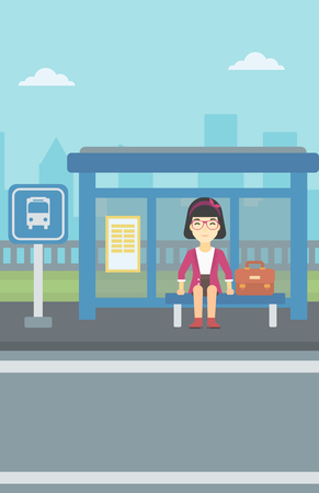 An asian woman with briefcase waiting for a bus at a bus stop on a city background. Young woman sitting at bus stop at the city street. Vector flat design illustration. Vertical layout.