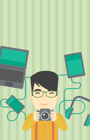 An asian young man taking photo with digital camera. Man surrounded with gadgets. Man using many electronic gadgets. Vector flat design illustration. Vertical layout. Illustration