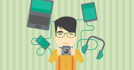 multiple ethnicities: An asian young man taking photo with digital camera. Man surrounded with gadgets. Man using many electronic gadgets. Vector flat design illustration. Horizontal layout. Illustration