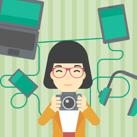 multiple ethnicities: An asian young woman taking photo with digital camera. Woman surrounded with her electronic gadgets. Woman using many electronic gadgets. Vector flat design illustration. Square layout.