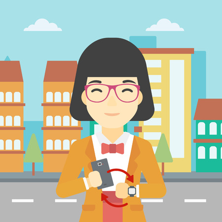 An asian young woman holding a smartphone looking at her smart watch. Concept of synchronization between smartwatch and smartphone. Vector flat design illustration. Square layout.