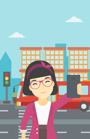 woman cellphone: An asian woman making selfie. Woman taking photo with cellphone. Woman looking at smartphone and taking selfie on the background of city. Vector flat design illustration. Vertical layout.
